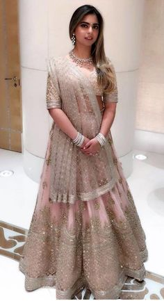 Isha Ambani wore an ethereal Sabyasachi lehenga for her pre-engagement party. She chose a tulle lehenga in powder pink, generously hand-embroidered using crystals, gold glass beads and sequins. Indian Wedding Outfits, Bridal Outfits, Indian Outfits, Lehenga Dupatta, Lehnga Dress, Heavy Lehenga, Designer Bridal Lehenga, Indian Bridal Lehenga, Sabyasachi Designer