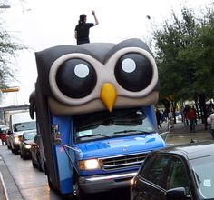 Mobile billboards abound at SXSW Interactive 2012, including this bus-turned-owl transporting HootSuite employees around the conference. Employees of the social media management tool perched on top of the giant owl (created by local Austin art fabricators Blue Genie) and tossed HootSuite-branded swag to fans on the street.