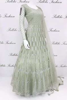 Stunning Light Pista Designer Outfit with Elegant Handwork Wear a lavish grace in this light pista designer floor length outfit featuring gorgeous petite stone & handwork & matching soft net duppata with stone work Indian Fashion Dresses, Indian Gowns Dresses, Dress Indian Style, Indian Designer Outfits, Pakistani Dresses, Modest Dresses, Stylish Dresses, Indian Outfits, Casual Dresses