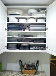 Adding extra shelves so baking pans and casserole dishes don't need to be stacked so much.   From Simple Organized Living