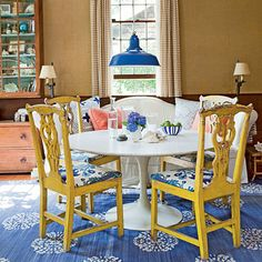 Blue and white dining area with burlap covered walls by designer Catherine Lippincott | Coastal Living