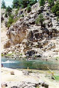 """Hot Creek about seven or so natural hot springs, suitable for soaking, in the an area of about eight square miles.   outside of the town of Mammoth Lakes. From US 395, go east on Hot Creek Hatchery Rd/ Airport. After less than a mile, you will see a sign to """"Hot Creek Geothermal Area"""". The last mile or so, before the parking lot, is unpaved."""