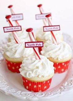 Super delicious looking Christmas cupcakes. The cupcakes are labeled north pole as they are decorated in white vanilla icing with candy canes and candy on top. Christmas Cupcakes Decoration, Holiday Cupcakes, Christmas Desserts, Christmas Baking, Christmas Treats, Holiday Treats, Holiday Recipes, Decorate Cupcakes, Christmas Christmas