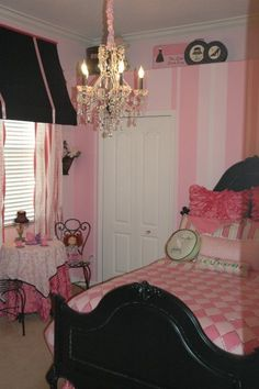 love the stripes on the wall. the black bed is gorgeous. and the little cafe table is so cute!