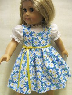 This is a sweet little outfit for your 18 American Girl doll. The fabric has bright white daisys scattered on a bright blue background. The jumper bodice is fully lined and fastens in back with velcro. It can be worn without the blouse as a sundress. Her crispy white blouse has puffy sleeves and lace-edged neckline. It also fastens in back with velcro. Doll/Shoes not included.