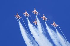 Photograph Flying High and Proud - RSAF Black Knights by GengHui Tan on 500px