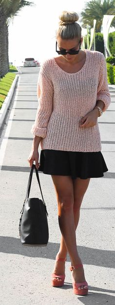 Pink & black outfit: sweater, skirt, sandals, bag.