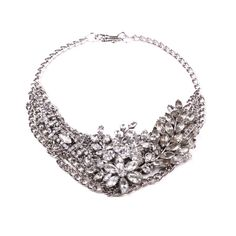 Sparkling necklace with vintage brooches on chain.