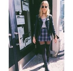 Leather jacket, flannel skirt, high socks, and grey t shirt