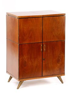 I just discovered this Mid Century Modern Bar Cabinet on LiveAuctioneers and wanted to share it with you: www.liveauctioneers.com/item/45862088
