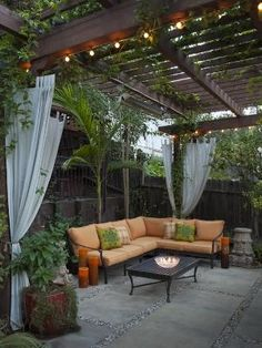Pergola and love the lights and curtains and greenery