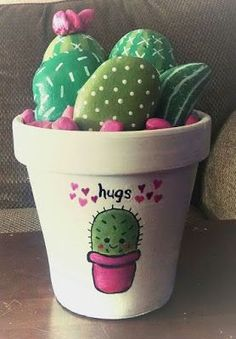 Cactus craft ideas - And finally. collect pebbles from the garden or beach, in assorted shapes and sizes, to make a colourful painted cactus display that would add colour and interest to any windowsill. Cactus Rock, Painted Rock Cactus, Painted Plant Pots, Painted Flower Pots, Cactus Cactus, Indoor Cactus, Cactus Diys, Indoor Plants, Flower Pot Crafts