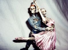 noisy as two skeletons dancing on a tin roof