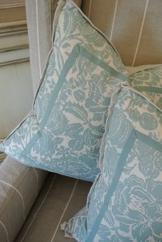 Aqua and white pillows with washable ribbon detail