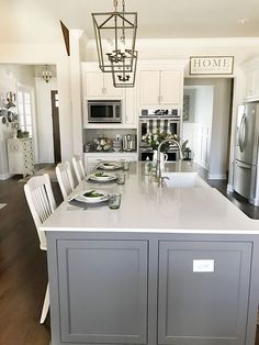 The countertops are a quartzite with a subtle gray and taupe marbling throughout. They are much more durable and resistant to stains and scratching. Countertop: Virginia Quartzite.