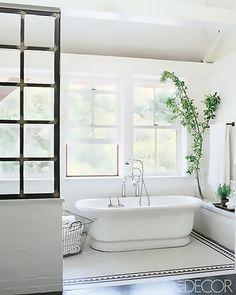 Inside Celebrity Homes Meg Ryan - Beach House Decor of Meg Ryan - ELLE DECOR tub, and shelf, and dark window, floor color Inside Celebrity Homes, Celebrity Houses, Bad Inspiration, Bathroom Inspiration, Bathroom Ideas, Open Bathroom, Earthy Bathroom, Bathroom Renovations, Relaxing Bathroom