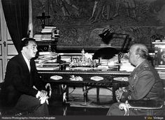 Salvador Dali having a conversation with the Spanish leader and dictator General Franco at El Pardo Palace in Madrid, 1956