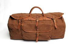 Leather and canvas are the materials of luggage.  This fine piece is made with leather reinforcements and brass buckles.  This is the first piece of luggage a man should own.