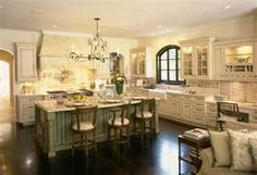 A great, big beautiful kitchen, of course to do this I would have to knock out a wall, or two....maybe the garage wall.