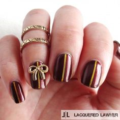 Burgundy nails are prefect for fall. Spice them up a bit with some gold accents.