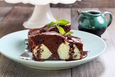 This isn't a typical poke cake. Instead of poking the holes in, prepared coconut ricotta balls will form holes and creamy pockets throughout your chocolate sponge cake! Cheap Chocolate, Chocolate Cheese, Melting Chocolate, Chocolate Recipes, Poke Cakes, Cupcake Cakes, Cupcakes, Chocolate Sponge Cake, Torte Cake