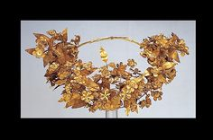 Heracles to Alexander the Great:  The Queen's wreath, c. 310 BC © This gold myrtle wreath is one of the most precious objects found in the antechamber of the tomb of Philip II. It is associated with his wife, Queen Meda; some 80 leaves and 112 flowers on the wreath have survived.