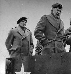 Generals In DB Overcoats.  The belt on the roll lapel DB that Eisenhower is wearing, when unbuttoned, flipped back, and buttoned in back, becomes the half belt seen on some city overcoats.