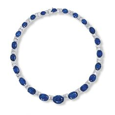 A SAPPHIRE AND DIAMOND NECKLACE Designed as a line of twenty-two graduated oval and cushion-shaped sapphires weighing a total of 98.90 carats, alternating with baguette-cut diamond links, mounted in platinum, 38.2 cm long