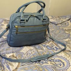 Olivia & Joy Cross Body Bag Large purse, great for days where you have to carry just about everything! Lots of pockets and a comfortable shoulder strap! Olivia + Joy Bags Crossbody Bags