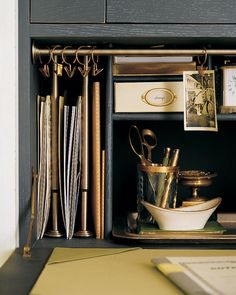Small brass tension rods hung vertically creat organizing slots, or horizontally can be a place to hang reminders