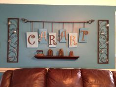 The letters are the first inital of all our names.  I used old shoe box lids, painted them, added the letters and attached them to a light weight curtain rod with ribbon.