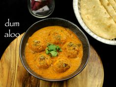 dum aloo recipe | punjabi dum aloo recipe | dhaba style dum aloo with detailed photo and video recipe. a rich and creamy potato based curry hails from the popular punjabi cuisine. the recipe is prepared with tomato and onion based sauce with deep fried baby potatoes.