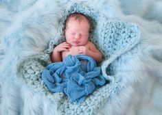 Super soft yet chunky! This gorgeous baby blue newborn mini baby blanket is made from a super cozy acrylic wool blend yarn with a soft furry yarn added for just the right touch. This is the perfect li