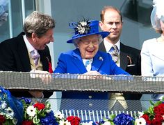 Gee-gee giggles ... Queen at Derby Day in 2012. ARTHUR EDWARDS / THE SUN