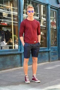 navy denim shorts, a red shirt and red high top Converse