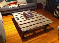 Coffee table made from a piece of old fence and steel plumbing pipe for the legs. Would be better with some plexiglass on top.