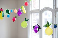 Fruit balloons by Brittany Watson Jepsen / Oh Happy Day. Photo by Hilda Grahnat.