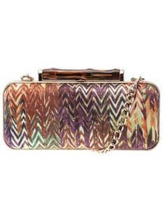 "Elaine Turner ""Angelina"" Canvas Clutch. Thatch print canvas clutch with gold-tone hardware and wood snap closure. Approximately 7in at widest point x 3in high x 2.5in deep. Snap closure. Optional chain link handle with 11in drop. Pink microsuede lining. $109.90 at ruelala.com"
