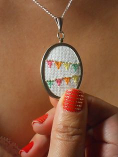 Flag Bunting Necklace to Celebrate Everyday - Cross-Stitch Pendant - MADE TO ORDER. $50.00, via Etsy.