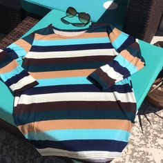 Pre Season Clearance Striped loose fit sweater Beautiful mix of colors in Browns,blues and creme. Best fit XL. Rounded CREWNECK, long length, lightweight. Boutique Sweaters Crew & Scoop Necks