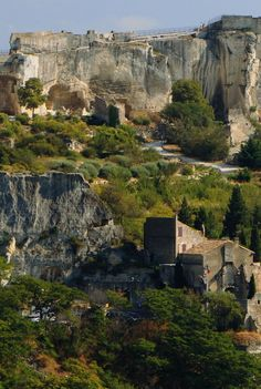 LES BAUX-DE-PROVENCE, Provence-Alpes-Cote d'Azur, France - This town is on a windswept plateau that overlooks vineyards and thousands of olive trees.  It has narrow, climbing streets and medieval 16th and 17th century stone houses.  It looks beautiful!