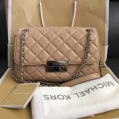 Michael kors shoulder purse Brand new & authenic .Comes with everything you see in picture: care card. Dust bag & mk bag. Quilt leather soft. Nude/beigeneutral color, strap can adjust worn as long/crossbody or shorter on shoulder. Very classy and chicluxury style. Serious buyers only. Thanks I'm a small person so the purse looks little longer on me on my last model picture☺️. Michael Kors Bags Shoulder Bags