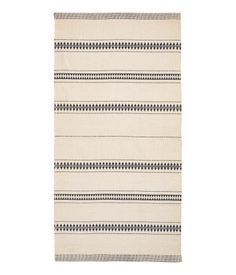 Natural white/black. Rug in woven cotton fabric with a printed pattern at front. (H & M: $30...for upstairs bathroom?)
