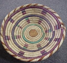"This is a large decorative basket fromAfrica.It has a14""diameter and is 5"" deep. It has a built-in loop so you can hang it on the wall. It also has a neat bottom, check it out. Plus the center is made"