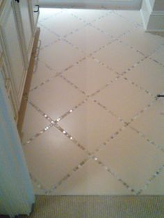 "For a dramatic effect, lay a thin strip of ""backsplash"" tile in between the large tiles, instead of just using grout."