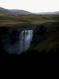 meeshelephant:  a little different kind of view of Skogafoss. I took this from the highway on the way to Vik. hills on top of hills on top of hills in the back.