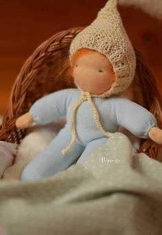 "This small cuddle doll Bebe. The doll size measures about 10 inch without hat. Her body is made of cotton velour. Her hair is a brushed mohair crocheted into a wig.  Eyes and mouth are hand embroidered with cotton thread. Body is stuffed with 100% organic pure wool and her skin is made of high quality Swiss cotton interlock. She wears a cute pointed hat (made with  ""La Fig"" hat pattern) and she has a cotton blanket. http://www.flickr.com/photos/puppula/ https://www.facebook.com/puppuladolls"