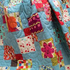 Colour Blocks Quilt Kit : This fun and simple kit use charm packs from the Avant Garden collection combined with a solid duck-egg blue for balance.