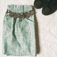 HP! J. Crew | Green tweed metallic miniskirt This skirt is perfect with tights and a statement necklace for all your winter fêtes! Green tweed-like material features metallic threads throughout. Pockets and belt loops. In good condition--only wear is a couple of stitches that have come loose at the front waist (see photo), giving the paperbag ruffle a bit more looseness. This could be easily fixed or worn as-is--it never bothered me!  No trades or PayPal. J. Crew Skirts Mini