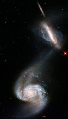 Two galaxies perform an intricate dance in this new Hubble Space Telescope image. The galaxies, containing a vast number of stars, swing past each other in a graceful performance choreographed by gravity.  The pair, known collectively as Arp 87, is one of hundreds of interacting and merging galaxies known in our nearby universe. Arp 87 was originally cataloged by astronomer Halton Arp in the mid 1960s. Arp's Atlas of Peculiar Galaxies is a compilation of astronomical photographs...